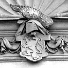 Různé podoby slánského znaku: Okresní dům (1902)
